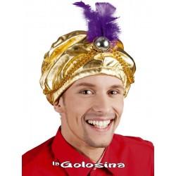 Turbante dorado con pluma